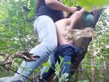 Hardcore lesbian sexual intercourse in the forest with a strap on